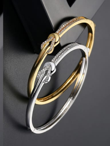 Copper inlaid AAA zircon noble gold knotted Bracelet