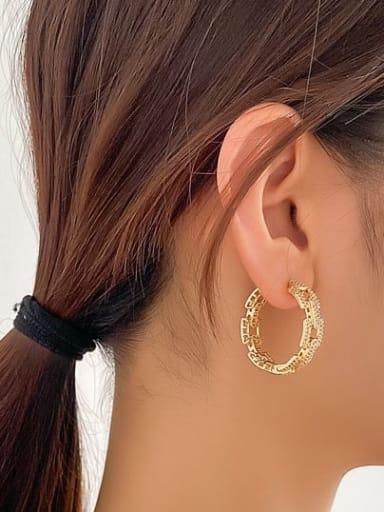 The gold earrings Brass Cubic Zirconia Round Luxury Huggie Earring