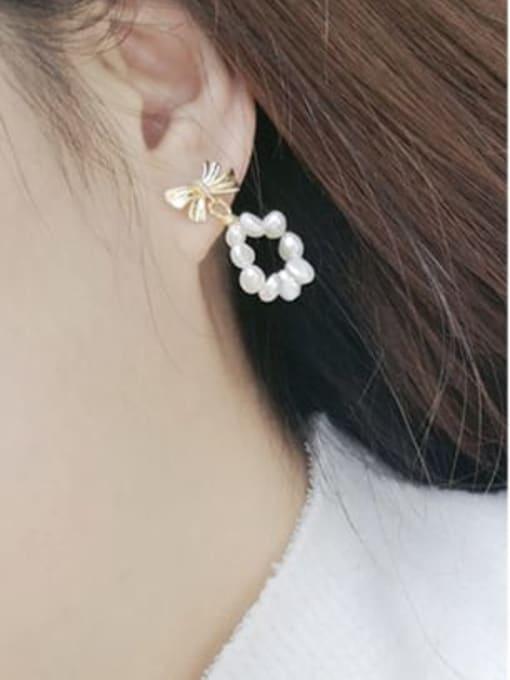 RAIN Brass Freshwater Pearl Bowknot Minimalist Drop Earring 1