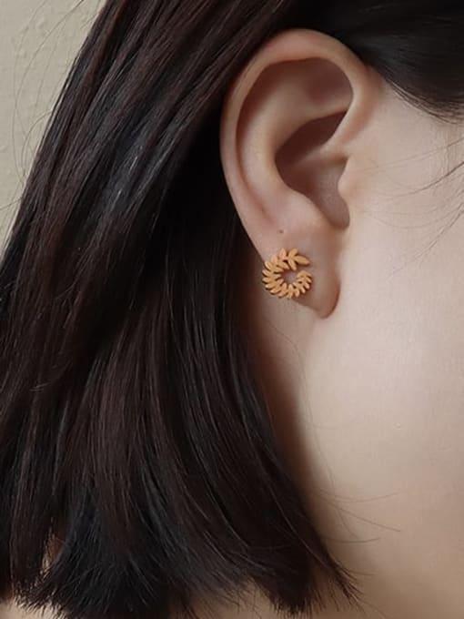 surrounded by golden rose leaves Titanium Steel Flower Minimalist Stud Earring