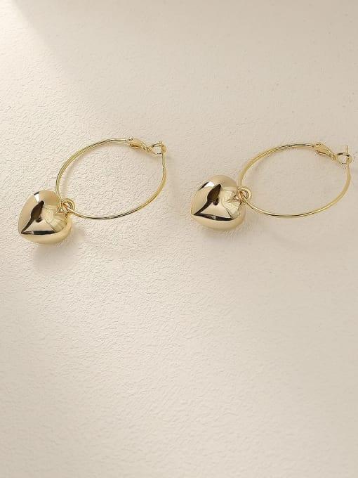 HYACINTH Brass Heart Minimalist Huggie Earring 2