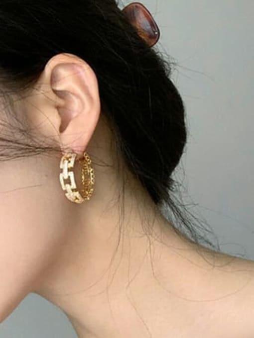 OUOU Brass Cubic Zirconia Geometric Statement Huggie Earring 1