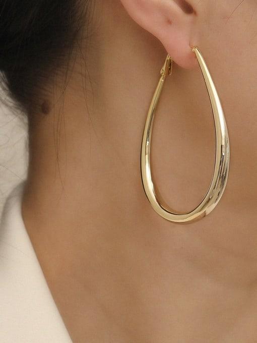HYACINTH Brass Hollow Geometric Minimalist Huggie Earring 1