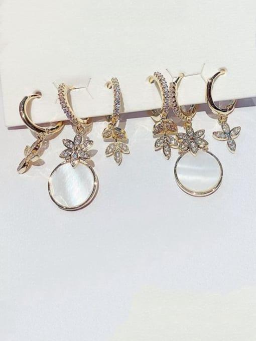 Ming Brass Shell Irregular Minimalist Huggie Earring 1