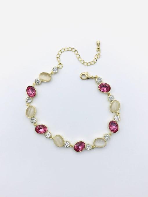 VIENNOIS Brass Glass Stone Red Oval Trend Bracelet